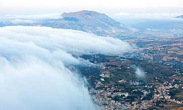 View over surrounding landscape from the city walls, clouds drifting across valley, Erice, Trapani, Sicily, Italy, Mediterranean, Europe