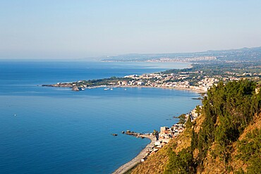 View from Piazza IX Aprile over the Bay of Naxos to distant Giardini-Naxos, early morning, Taormina, Messina, Sicily, Italy, Mediterranean, Europe
