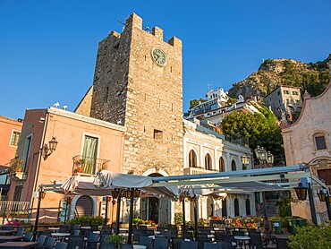 View from Piazza IX Aprile to the 12th century clock tower, Torre dell'Orologio, early morning, Taormina, Messina, Sicily, Italy, Mediterranean, Europe