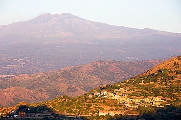 View across rolling volcanic landscape to the summit of Mount Etna, UNESCO World Heritage Site, at sunrise, Taormina, Messina, Sicily, Italy, Mediterranean, Europe