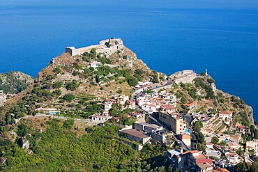 View over wooded valley to the Saracen castle and distant Ionian Sea, Castelmola, Taormina, Messina, Sicily, Italy