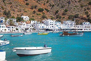 View across the turquoise waters of the harbour, Loutro, Hania (Chania), Crete, Greek Islands, Greece, Europe