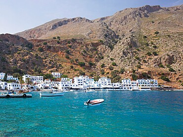 View across the clear turquoise waters of the harbour, Loutro, Hania (Chania), Crete, Greek Islands, Greece, Europe