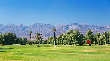View to the Panamint Range from the world's lowest-lying golf course, Furnace Creek, Death Valley National Park, California, United States of America, North America