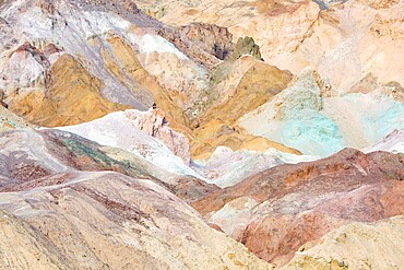 Visitor dwarfed by landscape of colourful rocks, Artist's Palette, Furnace Creek, Death Valley National Park, California, United States of America, North America