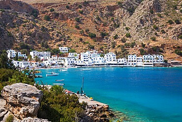 View across the tranquil waters of the harbour, Loutro, Hania (Chania), Crete, Greek Islands, Greece, Europe