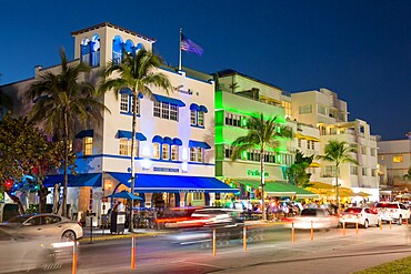 Colourful hotel facades illuminated by night, Ocean Drive, Art Deco Historic District, South Beach, Miami Beach, Florida, United States of America, North America