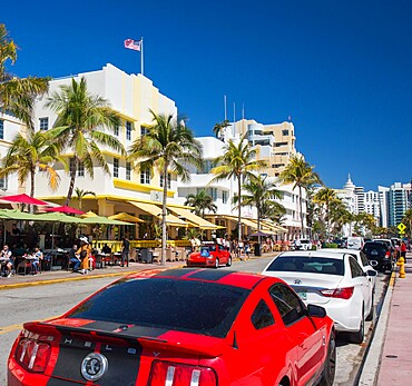 View along Ocean Drive, red Ford Mustang in foreground, Art Deco Historic District, South Beach, Miami Beach, Florida, United States of America, North America