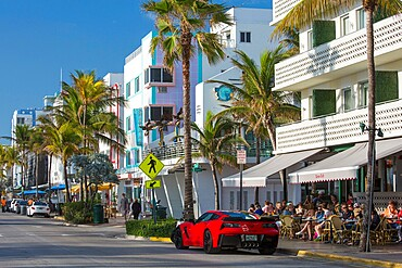 View along Ocean Drive, red Chevrolet Corvette prominent, Art Deco Historic District, South Beach, Miami Beach, Florida, United States of America, North America