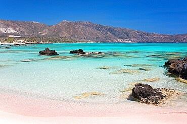 View across Vroulia Bay from beach of typically pink sand, Elafonisi Island, Elafonisi, Hania (Chania), Crete, Greek Islands, Greece, Europe