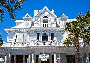 Brilliant white facade of the historic Curry Mansion, now a guest house, Old Town, Key West, Florida Keys, Florida, United States of America, North America