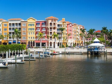 View across the Gordon River to the colourful architecture of Bayfront Place, Naples, Florida, United States of America, North America