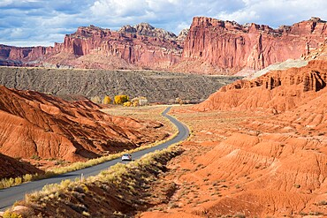 Car heading north along the Scenic Drive towards the Waterpocket Fold, Fruita, Capitol Reef National Park, Utah, United States of America, North America