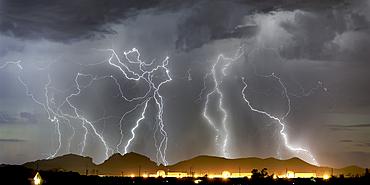 Lightning striking Saddleback Mountain just west of Tonopah, Arizona, United States of America, North America