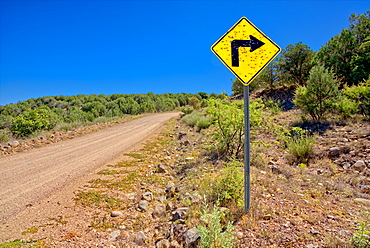 A sign along Forest Service Road 492 that has been shot up by reckless gunfire, Prescott National Forest, Arizona, United States of America, North America