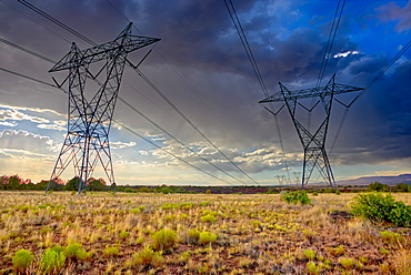 High voltage power lines stretching across Hell Canyon east of Paulden, located in the Prescott National Forest, Arizona, United States of America, North America