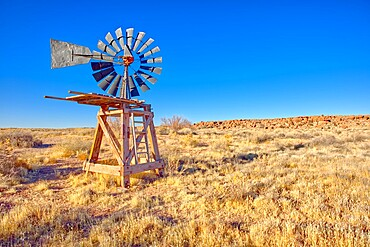 An old windmill marking the boundary of the Devil's Playground in Petrified Forest National Park, Arizona, United States of America, North America