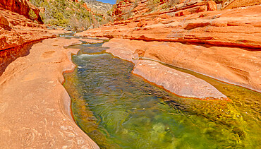 Slick rock water channel in Slide Rock State Park where most swimmers begin their slide in Oak Creek north of Sedona, Arizona, United States of America, North America