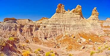 Panorama of 3 hoodoos on the edge of the Blue Mesa in Petrified Forest National Park Arizona that are shaped like kings.