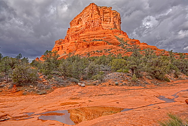 Reflections of Courthouse Butte in water puddles on its east side, located in Sedona, Arizona, United States of America, North America