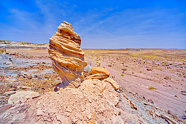 A hoodoo formation below the cliffs of Agate Plateau in Petrified Forest National Park Arizona called Medusa's Child.