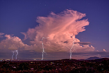 Isolated storm cell passing over the Prescott area of Arizona in the distance with the town of Chhino Valley in the foreground, Arizona, United States of America, North America