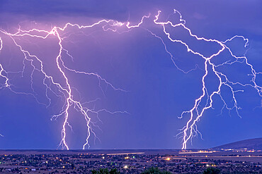 Lightning bolts striking Prescott area in the distance with the town of Chino Valley just north of Prescott Town in the foreground, Arizona, United States of America, North America