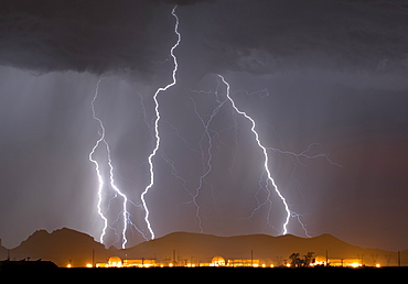 A large lightning storm behind a nuclear power plant in western Arizona during the 2014 Monsoon season, Arizona, United States of America, North America