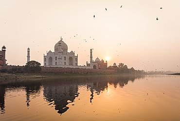 Taken from a boat on the River Yamuna behind the Taj Mahal at sunset, UNESCO World Heritage Site, Agra, Uttar Pradesh, India, Asia