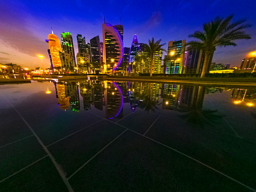 Illuminated cityscape skyline, West Bay skyline in the evening and reflections, Doha, Qatar, Middle East