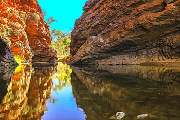 Scenic Simpsons Gap and permanent waterhole reflecting the cliffs in West MacDonnell Ranges, near Alice Springs on Larapinta Trail, Outback, Northern Territory, Australia, Pacific