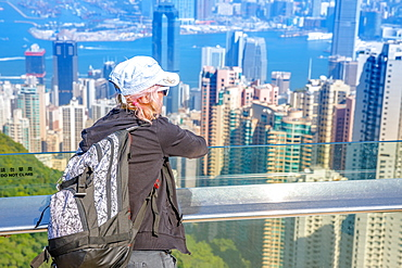 Tourist looking at the view of Victoria Harbour from Peak Tower, Hong Kong, China, Asia