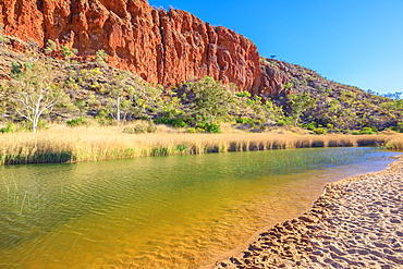 White sand at shoreline of waterhole at Glen Helen Gorge on Finke River in the dry season, West MacDonnell Ranges, Northern Territory, Central Australia, Pacific