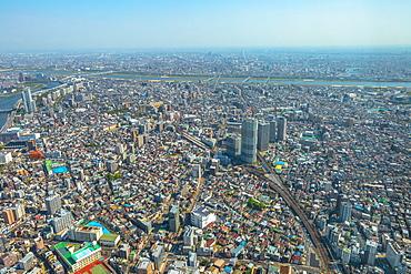 Aerial view of Tokyo city skyline with Asahi Beer Hall, Asahi Flame, Sumida River Bridges and Asakusa area, Tokyo, Japan, Asia