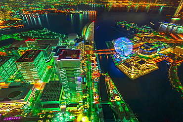 Aerial view of Yokohama Cityscape and skyline at night from viewing platform of Landmark Tower, with skyscrapers from observatory sky garden, illuminated railway and subway, Yokohama, Honshu, Japan, Asia