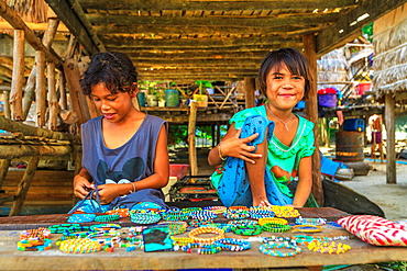 Sea Gypsies, little girls selling necklaces and bracelets in Moken tribe, fisherman village of Ko Surin Marine National Park, Surin Islands, Phang-Nga, Thailand, Southeast Asia, Asia