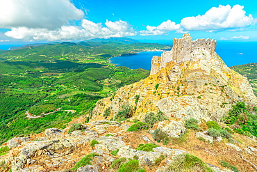 Iconic view from top of Elba mountain of Volterraio Castle on rock at 394 m, Fortress of Volterraio, symbol of Elba Island, dominates Portoferraio Gulf, Tuscan Archipelago, Tuscany, Italy, Europe
