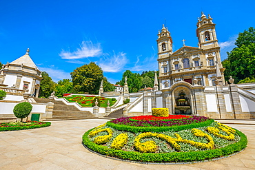 Neoclassical Basilica of Bom Jesus do Monte surrounded by gardens on a sunny day, a popular landmark and pilgrimage site, Tenoes, Braga, Minho, Portugal, Europe