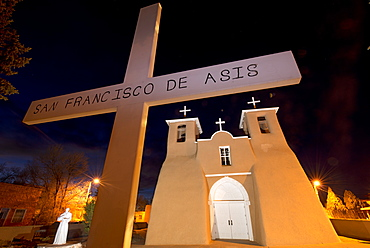 The historic adobe San Francisco de Asis church in Taos at twilight, Taos, New Mexico, United States of America, North America