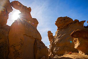 Sandstone sculptures and sun flare in Bisti/De-Na-Zin Wilderness in New Mexico, United States of America, North America