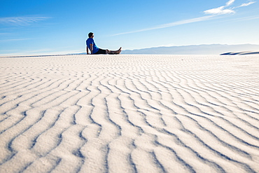 Man gazing out at the view in White Sands National Park, New Mexico, United States of America, North America