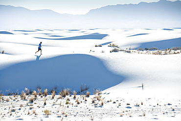 Jogging along a dune's ridge in White Sands National Park, New Mexico, United States of America, North America