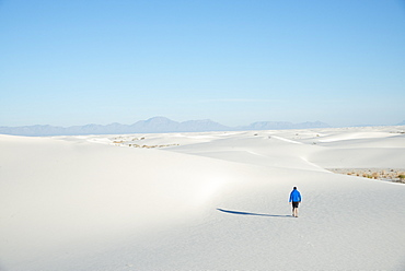 A man exploring the vast landscape of White Sands National Park, New Mexico, United States of America, North America