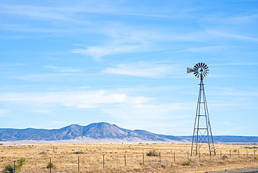 Windmill over ranchland in southern New Mexico, United States of America, North America