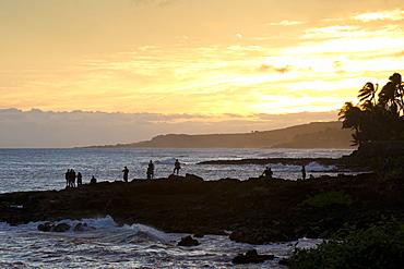 Watching the sunset along the southern coast of Kauai, Hawaii, United States of America, North America