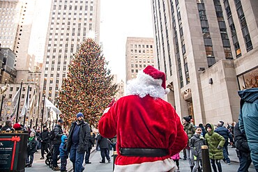 Santa Claus at the Rockefeller Square Christmas tree, Manhattan, New York City, New York, United States of America, North America