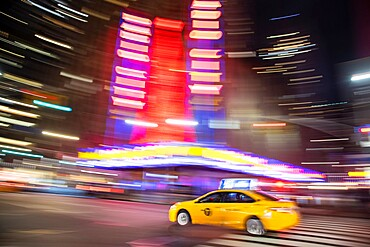 Taxis blurring down a street in Manhattan, New York City, New York, United States of America, North America