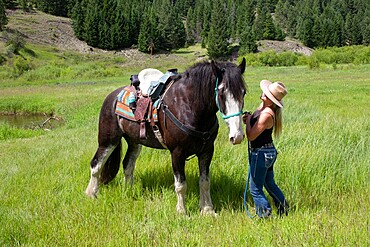 A woman enjoys a moment with her horse in rural British Columbia, Canada, North America