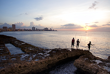 Fishing along the Malecon at sunset in Havana, Cuba, West Indies, Caribbean, Central America