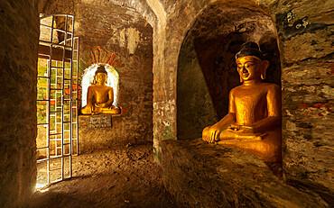 Buddha statues in the underground brick-lined corridors of Htukkant Thein Temple, Mrauk U, Rakhine, Myanmar (Burma), Asia